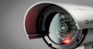 Close up image of a white security camera.