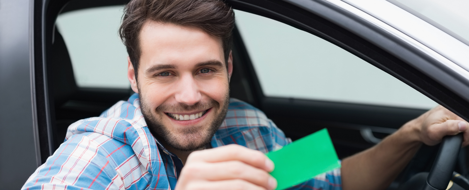 Person in a vehicle holding a landfill card