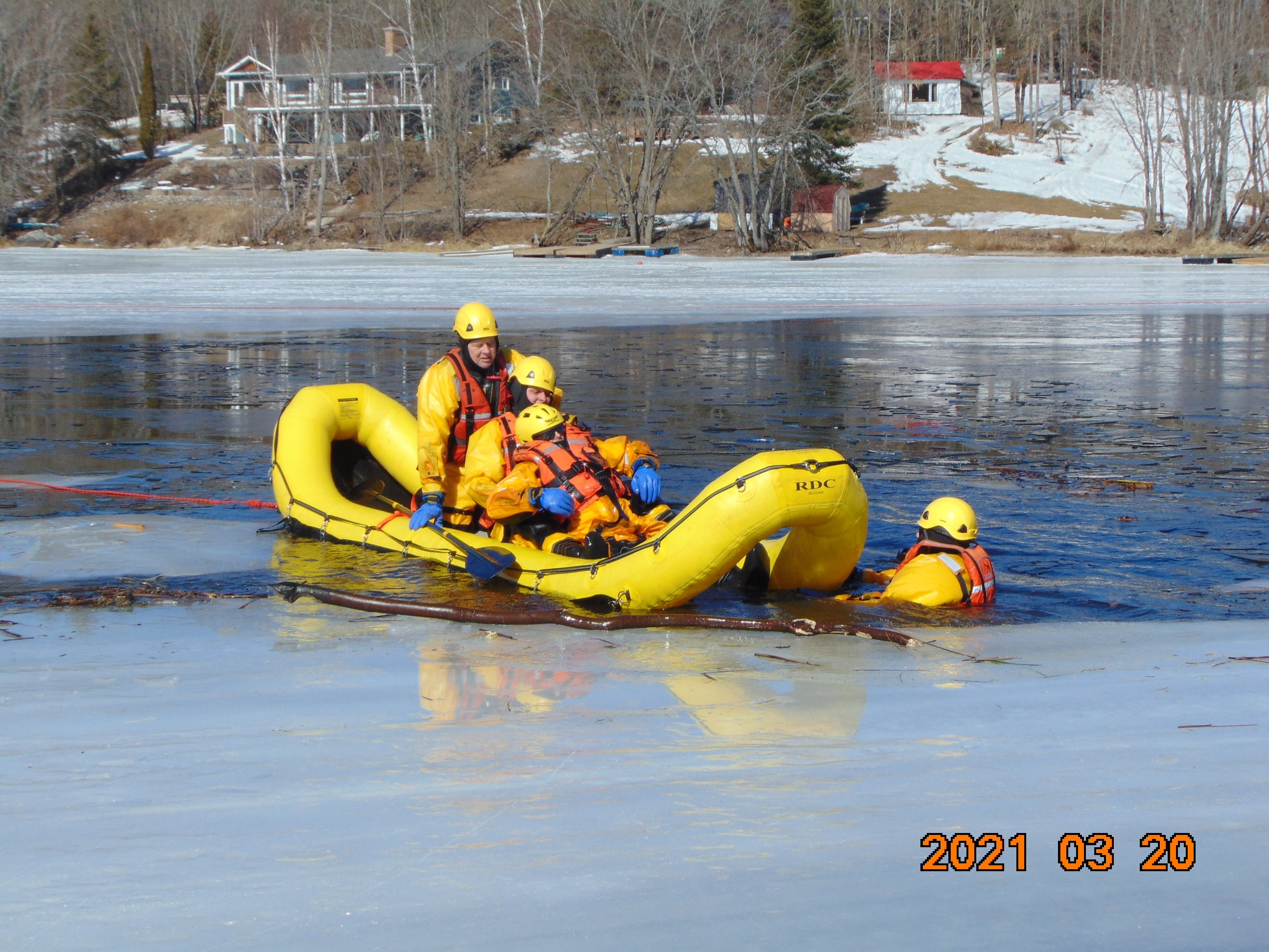 Members of the Dysart Fire Department in a Raft Practicing Ice Training